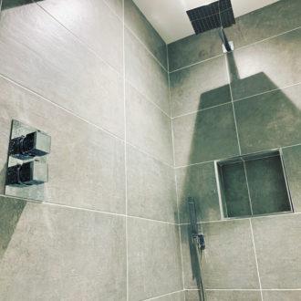 grey soul mid wall and floor tiles in bathroom