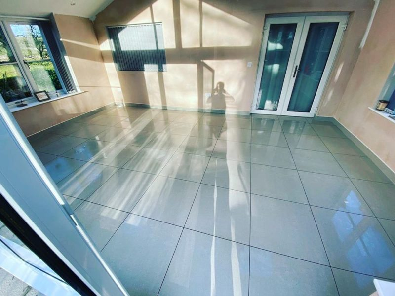 completed tiling of polished grey conservatory floor tiles 60 x 60