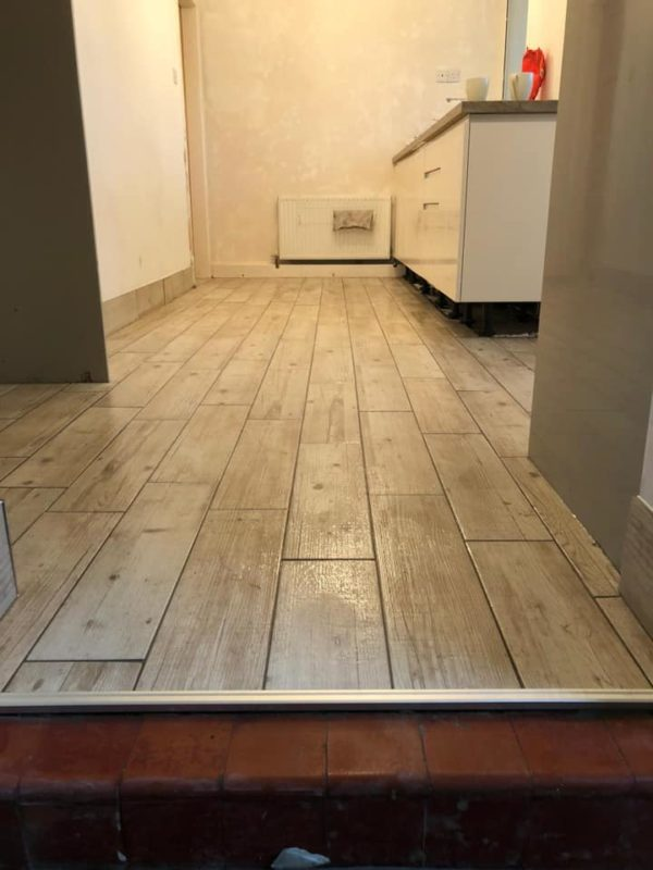 completed kitchen flooring in wood effect tiles