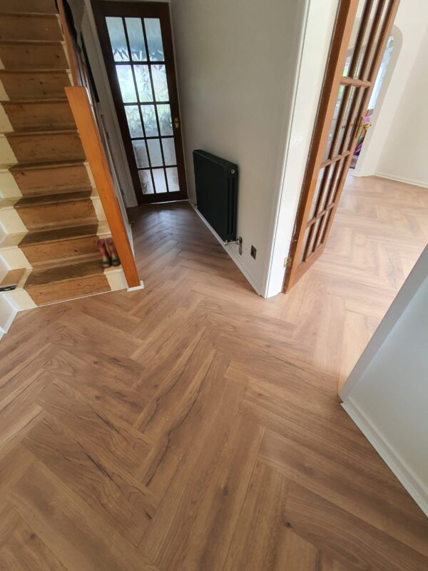 Herringbone laminate flooring in hallway