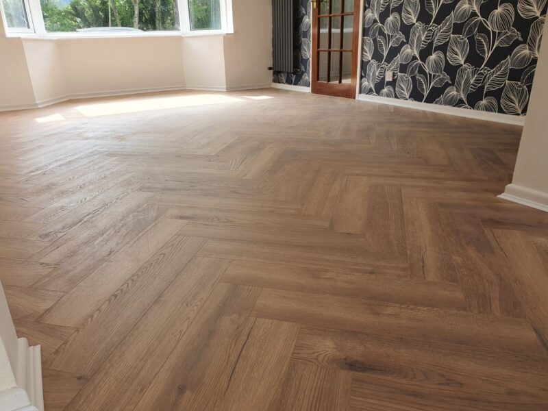 herringbone laminate flooring in livingroom